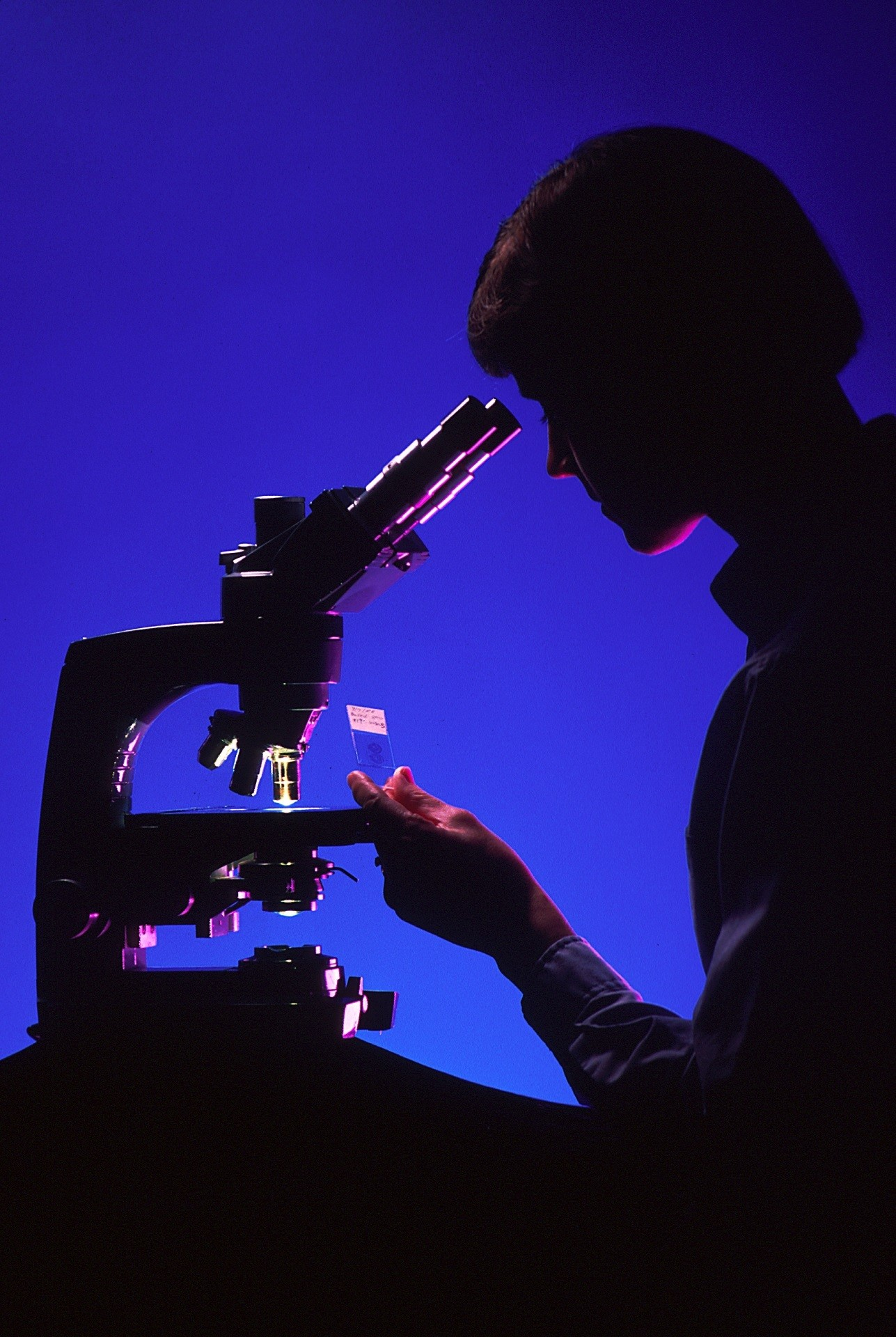 scientist-with-microscope-996187